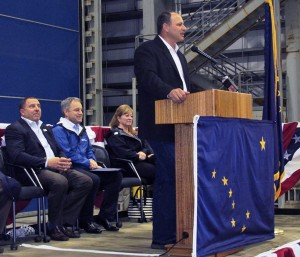 Vigor Alaska President Adam Beck speaks while Vigor CEO Frank Foti and Gov. Sean Parnell listen, seated.