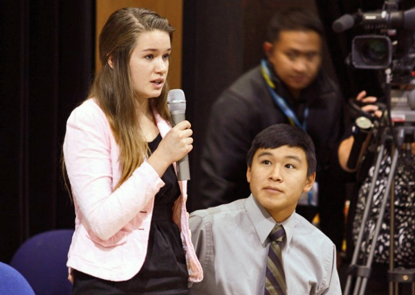 Nelson Kanuk, seated, and Katherine Dolma, standing, were two of the six young plaintiffs who sued the State of Alaska, demanding it take action on climate change. The pair are pictured here in Barrow, following a Supreme Court LIVE hearing at Barrow High School.  (Photo by Jeff Seifert/ KBRW)