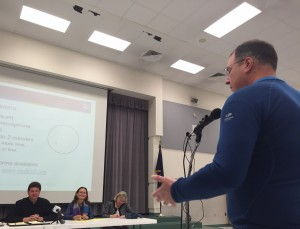 Community member giving comments during the meeting at Wendler Middle School.