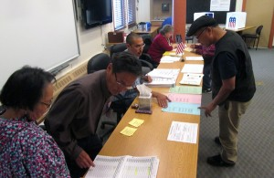 Voters at the Lower Kuskokwim School District choosing primary election ballots on Tuesday, August 19th, 2014.