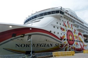 The cruise ship Norwegian Sun docks at Juneau's waterfront on one of the last days of 2014′s tourism season. (Ed Schoenfeld, CoastAlaska News)