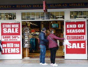Tourists consider checking out a sale on South Franklin Street, Juneau's gift-shop row, on one of the last days of 2014′s tourism season. (Photo by Ed Schoenfeld/CoastAlaska News)
