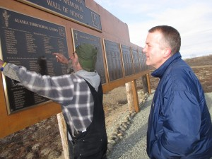 Sullivan visits the ATG Memorial Park Wall of Honor. (Photo by Ben Matheson / KYUK)