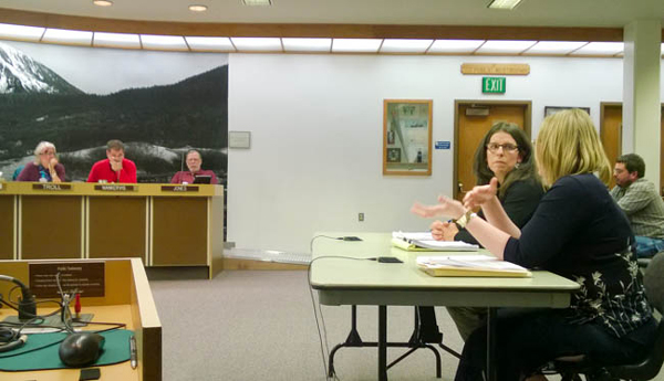 Michele Elfers listens as Wastewater Utility Superintendent Samantha Stoughtenger describes options for processing and disposing of biosolids at a Juneau Assembly Committee of the Whole meeting Monday. (Photo by Jeremy Hsieh/KTOO)