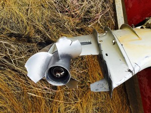 A broken outboard prop with significant damage to tabs on the lower unit. (Photo by Roderick Phillip)