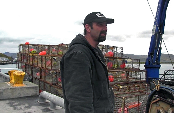 Captain Moore Dye of the F/V Western Mariner gears up for crab season this week in Dutch Harbor. (Annie Ngo/KUCB)