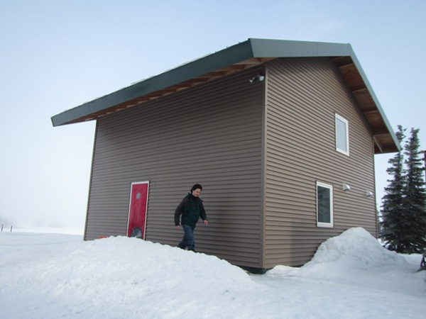 UAF Professor Tom Marsik, who now teaches at the Bristol Bay Campus, at his home in Dillingham. The 600-square-foot, extremely energy-efficient house has been certified as the world's most airtight house. (Credit KDLG)