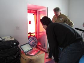 "Marsik and friend Gordon Isaacs conduct a blower door test on Marsik's home in March 2013 to determine how tightly it's sealed. The test was certified by the World Record Academy, which declared the structure was ""the world's most airtight house."" (Credit KDLG)"