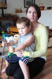 Heather Carlton and 2-year-old son Theo were at home Thursday after Spunky Sprouts Too suddenly shut down. (Photo by Lisa Phu/KTOO)