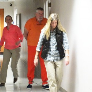 Dr. Greg Salard is escorted by U.S. Marshals as he appears in U.S. District Court in Juneau. (Photo by Matt Miller/KTOO)