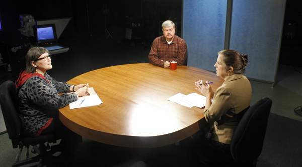 Valeri Davidson (left) and Walt Monegan (middle), talk with host Lori Townsend (right) on Alaska Edition. (Photo by Josh Edge, APRN - Anchorage)