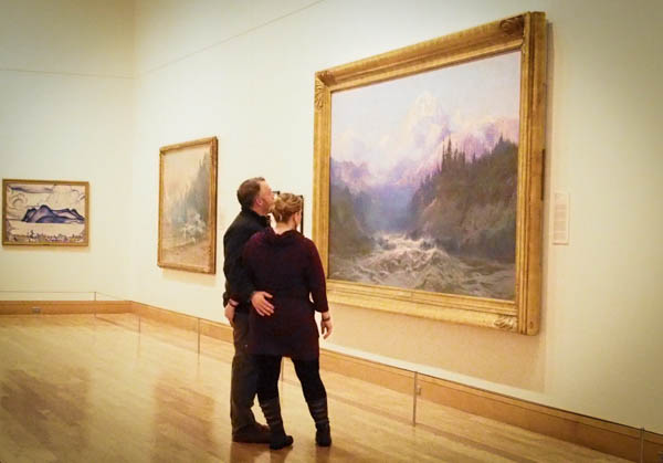 "A couple takes in Sydney Laurence's ""Mt. McKinley"" on Friday night in the Gallery of the Far North. Photo: Zachariah Hughes, KSKA."