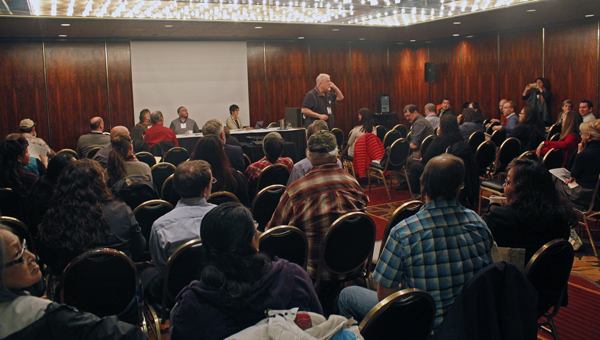 Bruce Botelho leads a discussion on rural self-governance in Anchorage. (Photo by Josh Edge, APRN - Anchorage)