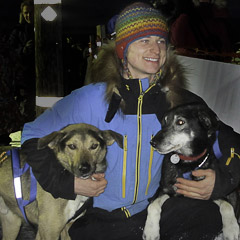2014 K300 champion Rohn Buser congratulates his lead dogs after his 2nd Kuskokwim 300 win.
