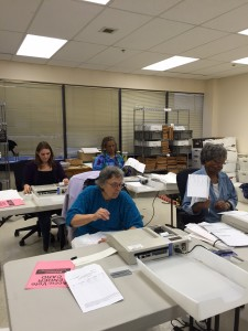 Workers at the Division of Elections scan early, question, and absentee ballots. Hillman/KSKA