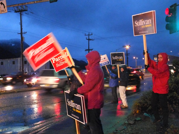 Republican sign wavers at 10th Street and Egan Drive in Juneau try to get the attention of evening commuters on Election Day. Capital city voters broke toward Democratic candidates in Alaska's Congressional races. (Photo by Matt Miller/KTOO)