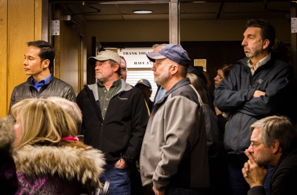 Business owners, nonprofit workers, and residents (including Rep. Neal Foster, left) made for a full house in Nome City Council chambers Monday as the council debated contentious tax issues. (Photo: Matthew F. Smith, KNOM)