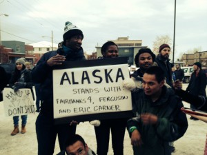 Supporters of justice for all people gather in the NAACP parking lot after a march through downtown Anchorage