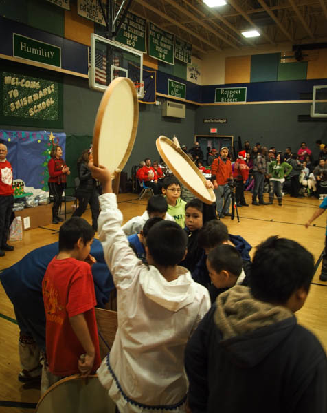 Boys eagerly grabbed at drums after the adults had taken up their own, and took turns drumming and dancing. Photo: Zachariah Hughes, KSKA.