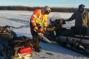 Search and rescue crews used chainsaws to cut the ice open during their search. (Photo courtesy of BSAR)