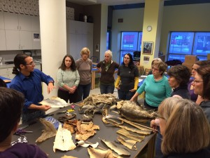 Joel Isaak shows off different fish skin leather examples during a workshop at the Anchorage Museum. Hillman/KSKA