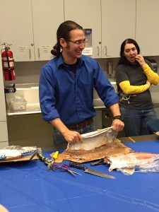 Joel Isaak demonstrates skinning fish and cleaning the skin at a workshop at the Anchorage Museum. Hillman/KSKA