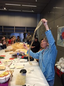 Elaine Kingeekuk shows off different types of guts to a group of elementary school students at the Anchorage Museum. HIllman/KSKA