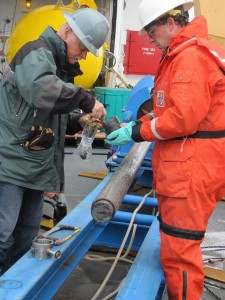 Chief scientist Brian Edwards collecting samples from the gravity corer. (Photo by Helen Gibbons, USGS/ECS Project)