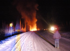 The fire that burned the wrecked tanker lights up the night. The rig caught fire after Big State Logistics removed the remaining 9,000 gallons of fuel from it. (Credit Alaska Department of Transportation and Public Facilities)