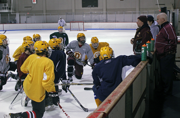 Dennis Sorenson coaches Dimond High School's varsity hockey team. (Photo by Josh Edge, APRN - Anchorage)