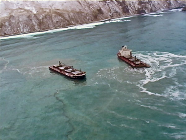 An oil sheen is visible at the wreck of the Selendang Ayu December 2004. (Lauren Adams/KUCB Archive Footage)