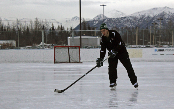 Tanner Sorenson skating at the Bonnie Cusack outdoor ice rink. (Photo by Josh Edge, APRN - Anchorage)