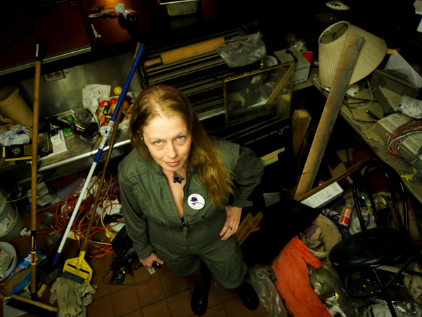 Shaubach stands in a corner of the industrial kitchen she says had been left in a state of disarray by the time she returned to the space for the first time since December. Photo: Zachariah Hughes, KSKA.