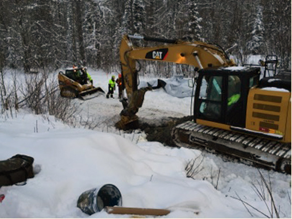 Excavator preparing a test hole on east side of the highway, December 15, 2014 (Photo/Engles-ADEC)