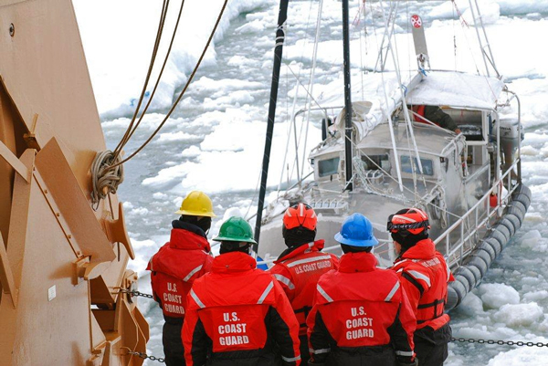 41 foot sailing vessel Altan Girl is towed out of the sea ice by USCGC Healy after getting stuck about 40 miles northeast of Barrow in July 2014. (Photo by Ensign Carolyn Mahoney, U.S. Coast Guard)