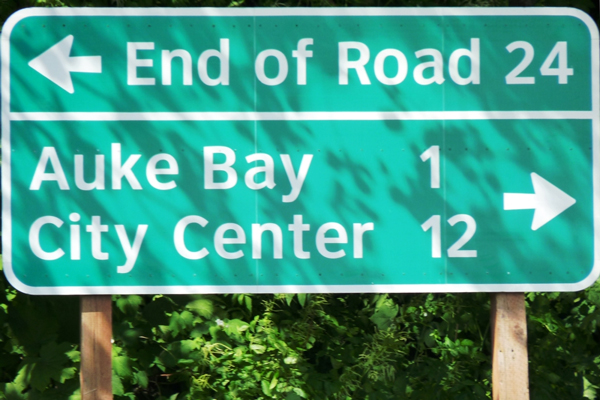 A sign near Juneau's Auke Bay Ferry Terminal points to the end of Glacier Highway. The road would be extended about 50 miles to a new terminal closer to Haines under a state plan that's temporarily on hold. (Ed Schoenfeld/CoastAlaska News)