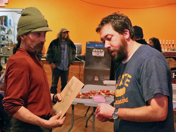 Musher Lance Mackey files paperwork with K300 Race Manager, Zack Fansler Thursday. – (Photo by Dean Swope)