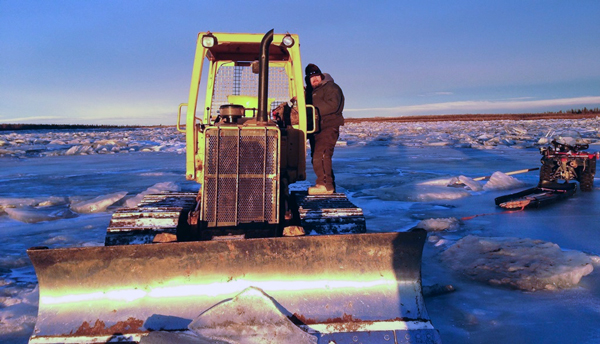 Oscar Samuelson helped with clearing the ice jam near Kalskag. (Photo Courtesy of Mark Leary)