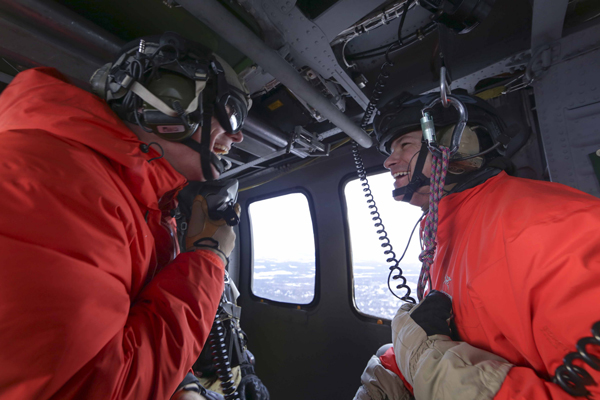 "Alaska Air National Guardsmen with the 201th, 211th and 212th Rescue Squadrons participated in a training mission near Mount Susitna Dec. 16. Guardian Angels from the 212th Rescue Squadron jumped from an HC-130 ""King"" aircraft from the 211th Rescue Squadron at approximately 10,000 feet before being transported by an HH-60 Pave Hawk helicopter from the 210th Rescue Squadron back to Joint Base Elmendorf-Richardson. A tandem jump and hoist training were also completed during the training mission. (U.S. Army National Guard photo by Sgt. Balinda O'Neal)"
