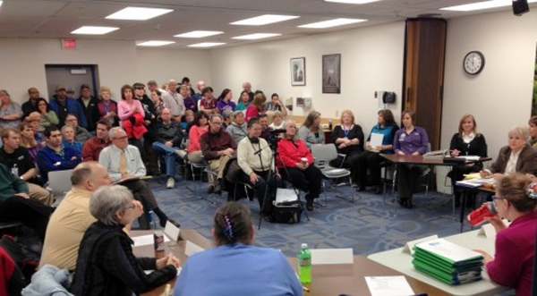 "The hospital classroom fills for the board's noon meeting. Staffers urged transparency as the board moves forward. ""A lot of what's happened has been a mystery to us,"" said one. (KCAW photo/Robert Woolsey)"