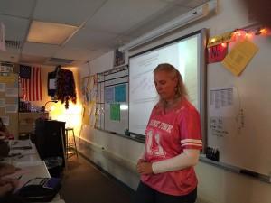 Math teacher Piper Jones listens to her students before distributing a quiz.