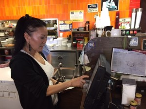 Susie Sander at the register at Peggy's Restaurant in Anchorage. Hillman/KSKA