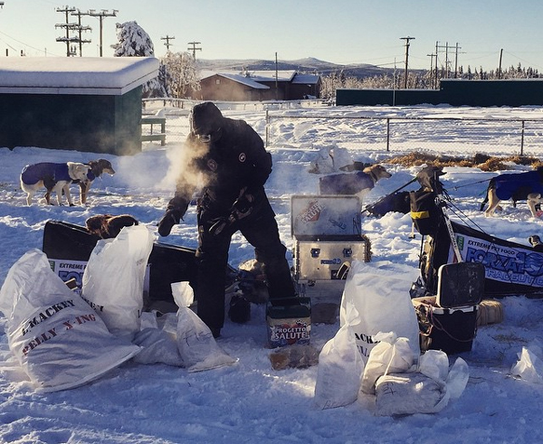 Lance Mackey cooks up a snack for his dogs. (Photo by Emily Schwing, KUAC - Fairbanks)