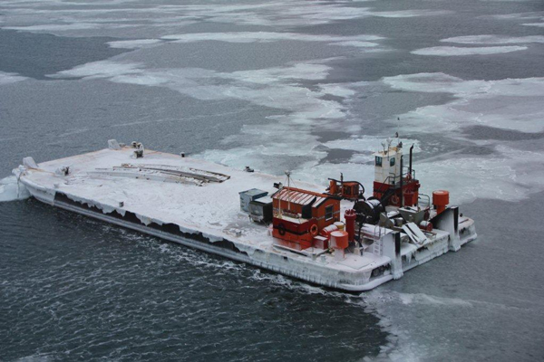 The barge was already partially ice-bound on Oct. 31, 2014, as seen from a Coast Guard aircraft in Alaska's Arctic. (Courtesy: Cmdr. Shawn Decker/USCG)