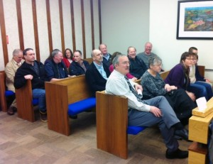 Ketchikan Gateway Borough officials attend Friday's hearing in Judge William Carey's courtroom.