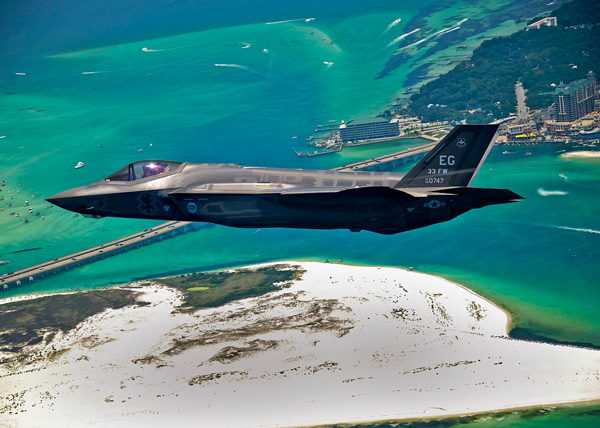 The Department of Defense's first U.S. Air Force F-35 Lightning II joint strike fighter (JSF) aircraft soars over Destin, Fla., before landing at its new home at Eglin Air Force Base, July 14, 2011. (U.S. Air Force photo by Staff Sgt. Joely Santiago)