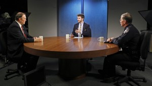 Anchorage Assembly member Paul Honeman (left) and Anchorage Police Department Chief Mark Mew (right) talk with Zachariah Hughes (center) on Alaska Edition. (Photo by Josh Edge, APRN, Anchorage)