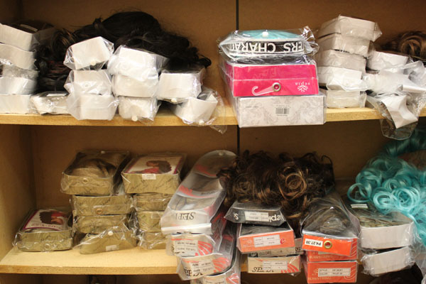 The shelves in James Hoagland's studio are filled with synthetic hairpieces and wigs. (Photo by Lisa Phu/KTOO)