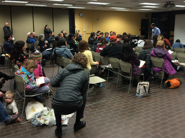 Scott Hamel answers questions from concerned parents and community members about the university's decision to terminate it's long-standing agreement with Tanaina. (Photo by Josh Edge - APRN - Anchorage)