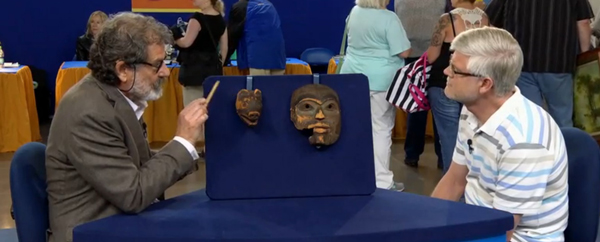 Appraiser Tim Trotta with the unidentified owner of the masks. (PBS Antiques Roadshow image.)